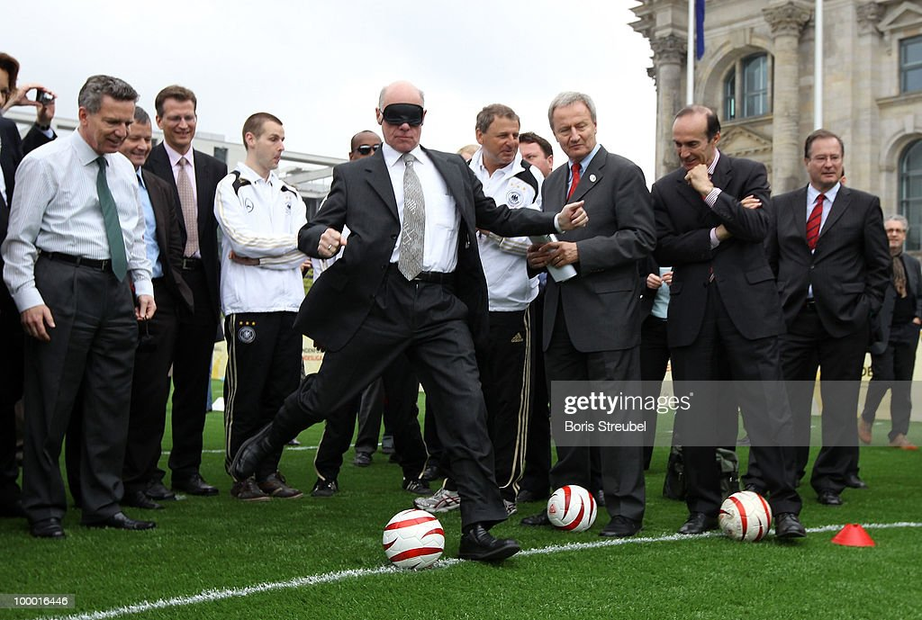 Norbert Lammert, president of the Bundestag handicaped with a mask, kicks a penalty on the 'Day of Blind Football�' in front of the Reichstag on May 20, 2010 in Berlin, Germany.