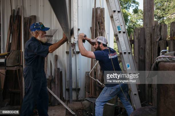 Norbert LeBlanc and his greatgrandson Bronson Cruder put up siding on LeBlancs workshop in St Matin Parish on June 7 2017 'If you have something you...
