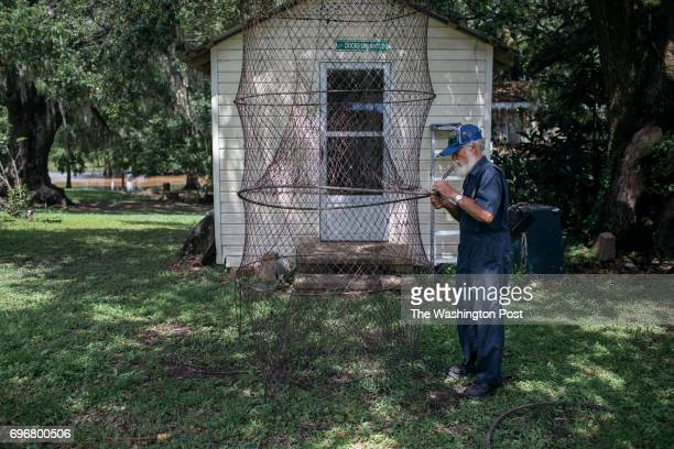 Norbert LeBlanc mends a fishing net at his home in St Martin Parish on June 7 2017 'The Cajun has to do everything by handeverything' he said while...