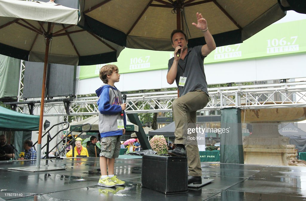 Norbert Leo Butz and Zachary Unger (L) of 'Big fish' on stage at 106.7 LITE FM's Broadway in Bryant Park 2013 at Bryant Park on August 1, 2013 in New York City.