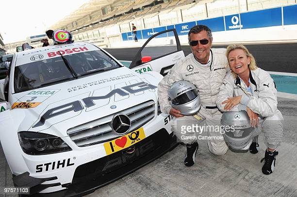 Norbert Medus and German TV Host Sabine Christiansen attend the Laureus Driving Experience for Good part of the Laureus Sports Awards 2010 at the Yas...