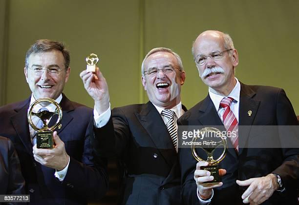 Norbert Reithofer CEO of car maker BMW Martin Winterkorn CEO of car maker Volkswagen and Dieter Zetsche CEO of car maker Daimler AG attend the 'Das...