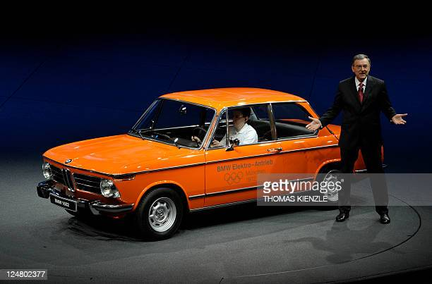 Norbert Reithofer CEO of German luxury car maker BMW presents one of the first BMW electric cars a BMW 1602 from 1972 at the booth of German luxury...