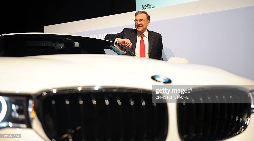 Norbert Reithofer, CEO of the German carmaker BMW, poses near a BMW 3 Series Grand Turismo displayed on the stage during the company's annual press conference in Munich, southern Germany, on March 19, 2013. German top-of-the-range carmaker BMW said today it is 'cautiously optimistic' for business in 2013 after achieving the best year in the company's history last year. STACHE