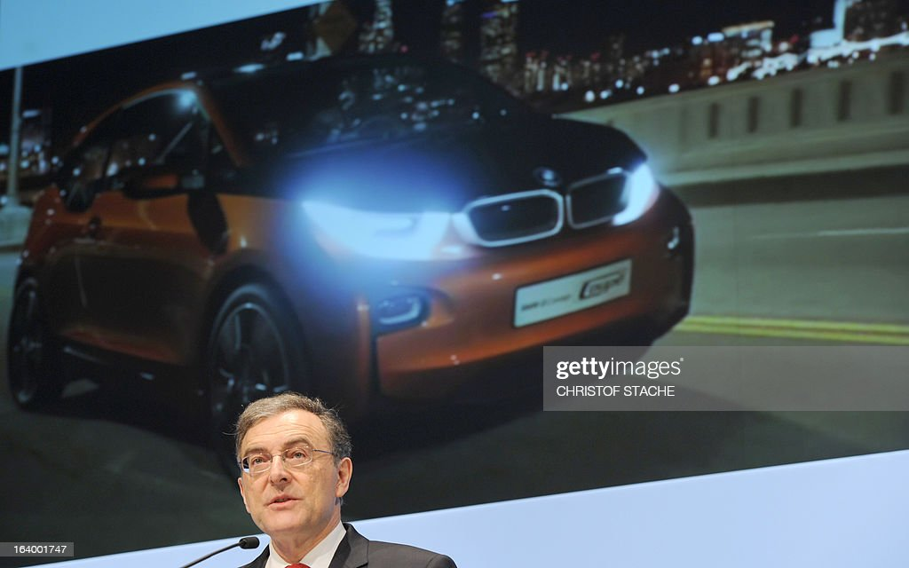 Norbert Reithofer, CEO of the German carmaker BMW, speaks in front of a board displaying a photo of a car during the company's annual press conference in Munich, southern Germany, on March 19, 2013