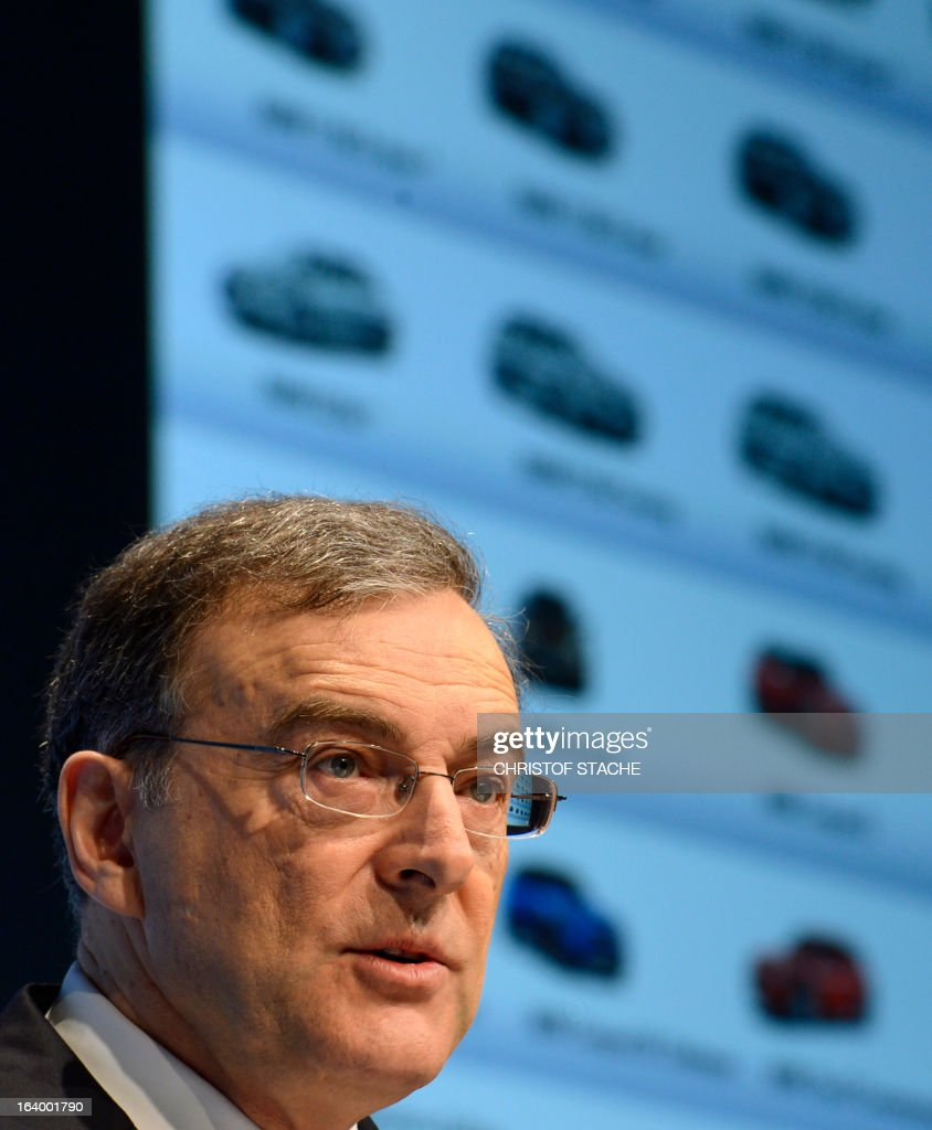 Norbert Reithofer, CEO of the German carmaker BMW, speaks in front of a giant board displaying images of cars during the company's annual press conference in Munich, southern Germany, on March 19, 2013. German top-of-the-range carmaker BMW said today it is 'cautiously optimistic' for business in 2013 after achieving the best year in the company's history last year. STACHE