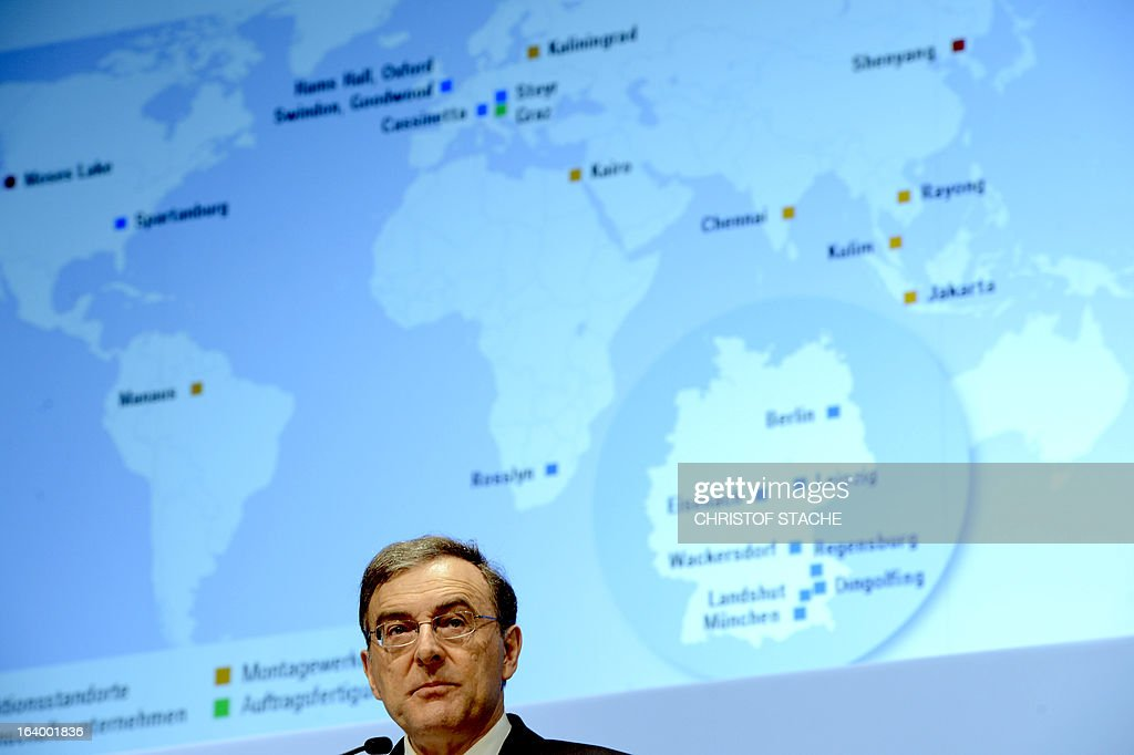 Norbert Reithofer, CEO of the German carmaker BMW, speaks in front of a giant board displaying a world map during the company's annual press conference in Munich, southern Germany, on March 19, 2013. German top-of-the-range carmaker BMW said today it is 'cautiously optimistic' for business in 2013 after achieving the best year in the company's history last year. STACHE