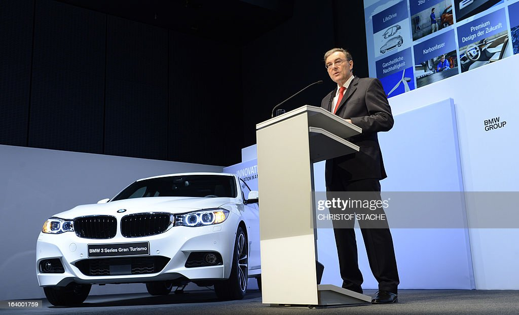 Norbert Reithofer, CEO of the German carmaker BMW, speaks near a BMW 3 Series Grand Turismo displayed on the stage during the company's annual press conference in Munich, southern Germany, on March 19, 2013. German top-of-the-range carmaker BMW said today it is 'cautiously optimistic' for business in 2013 after achieving the best year in the company's history last year. STACHE