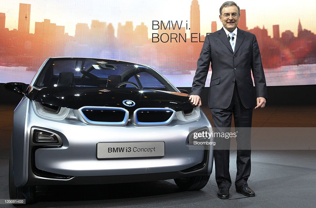 Norbert Reithofer chief executive officer at Bayerische Motoren Werke AG stands next to the company's i3 concept automobile during its unveiling in...