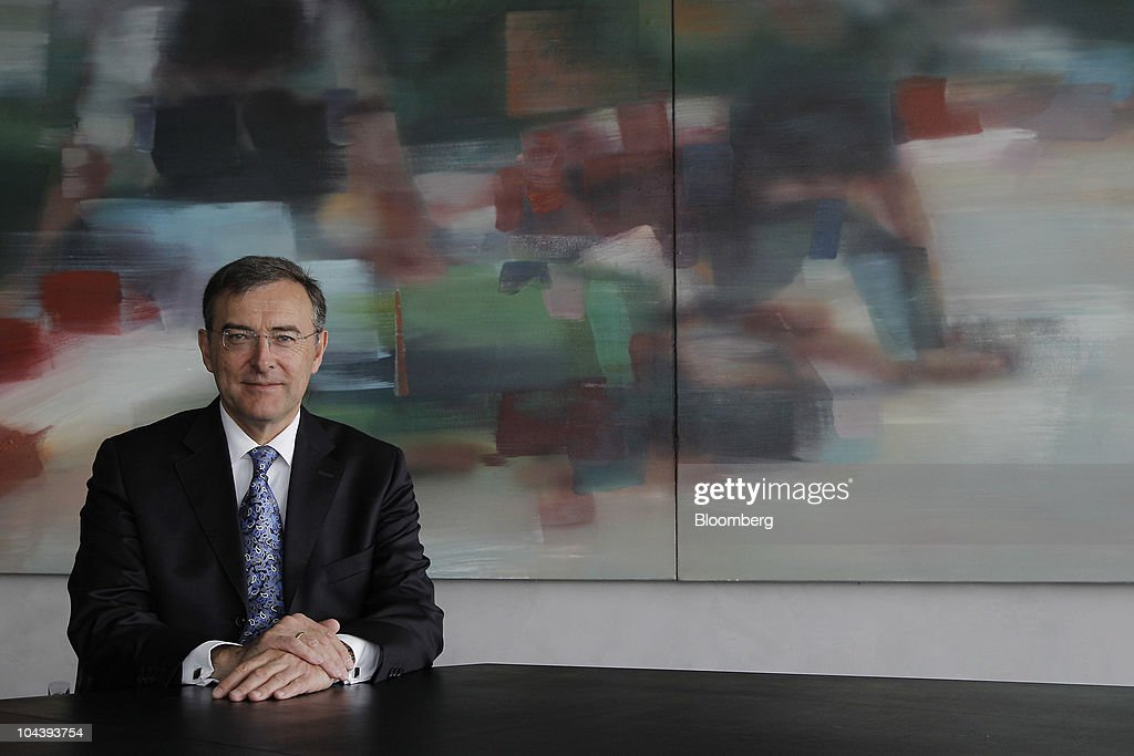Norbert Reithofer chief executive officer of Bayerische Motoren Werke AG poses for a photograph in the company's management board meeting room in...