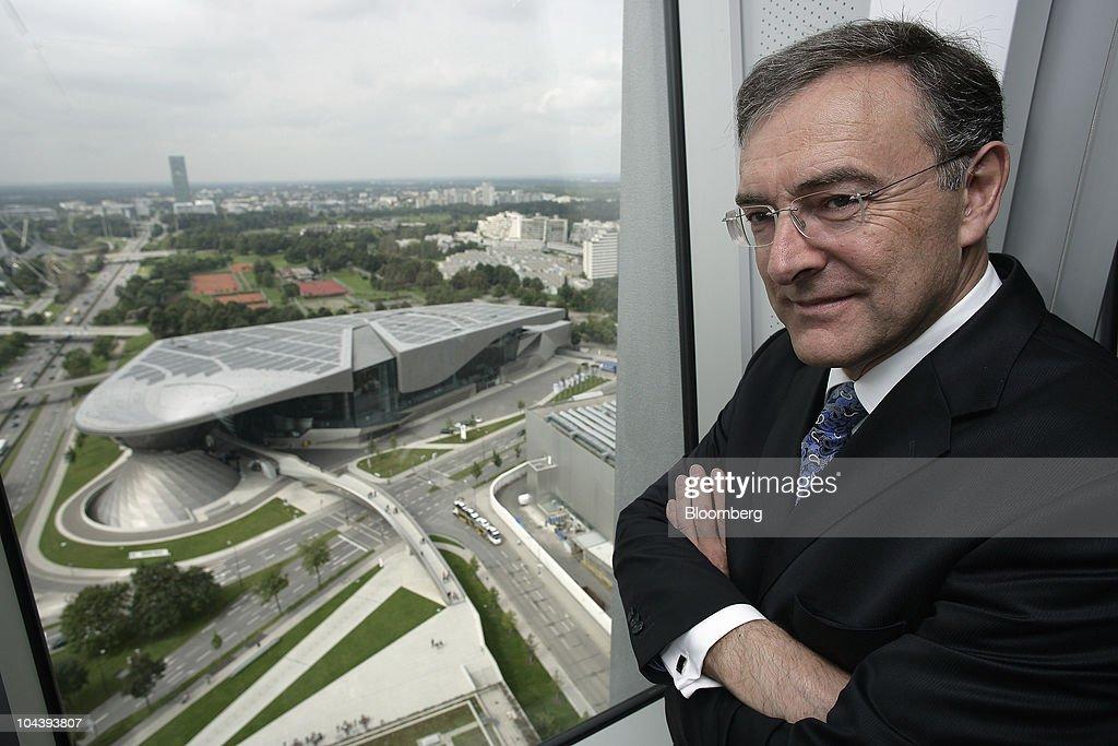 Norbert Reithofer chief executive officer of Bayerische Motoren Werke AG poses for a photograph at a window overlooking the BMW World customer center...