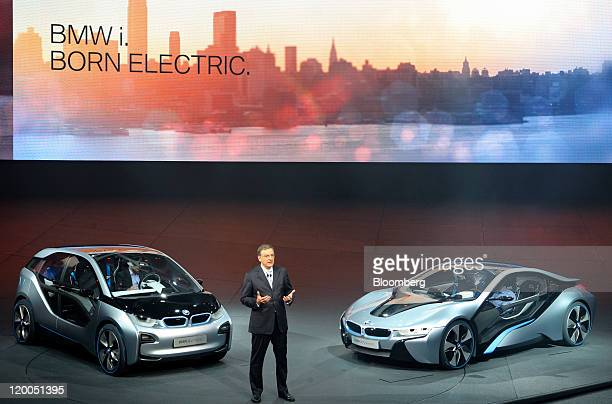 Norbert Reithofer chief executive officer of Bayerische Motoren Werke AG speaks as he stands between i3 left and i8 concept automobiles during their...