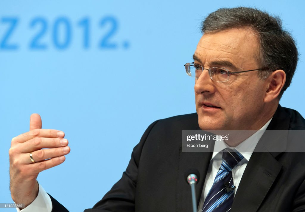 Norbert Reithofer chief executive officer of Bayerische Motoren Werke AG gestures during the company's annual news conference in Munich Germany on...