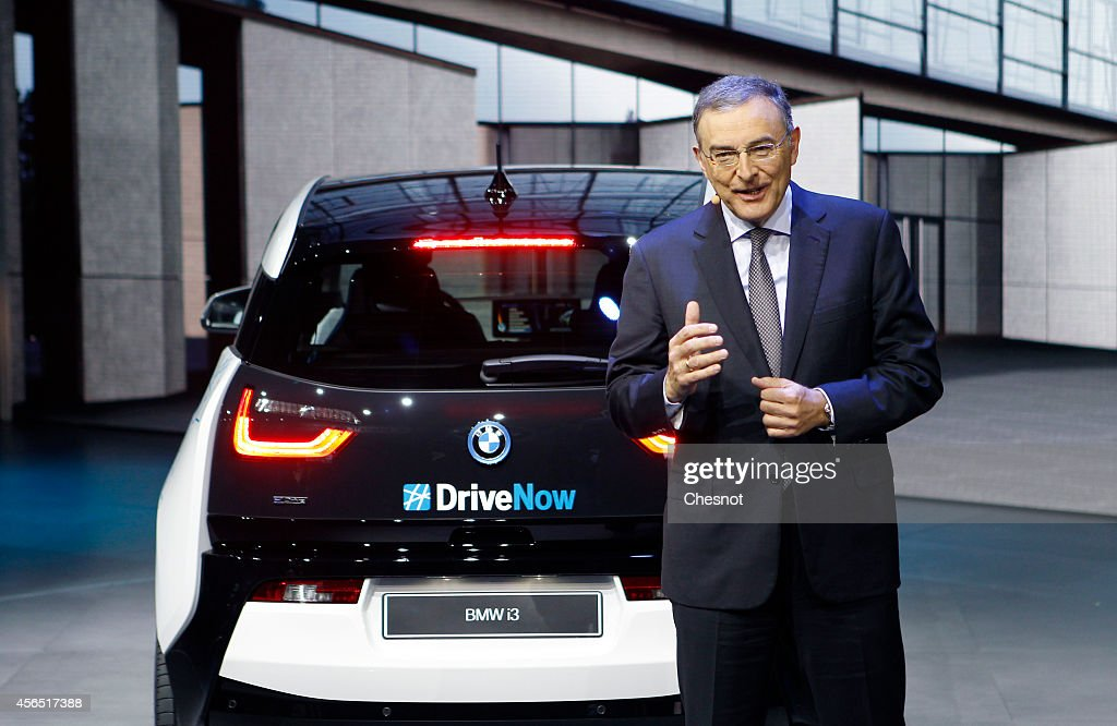 CEO Norbert Reithofer delivers a speech as he presents the BMW i3 during the press day of the Paris Motor Show on October 02 in Paris France The...