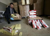 Norbert Scheithauer of the German customs presents a portion of 86 million smuggled cigarettes recently confiscated by German police in a Berlin...