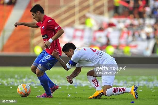 Norberto Araujo of Ecuador's Liga de Quito vies for the ball with Juan Arguello of Paraguay's Nacional during their Copa Sudamericana football macth...