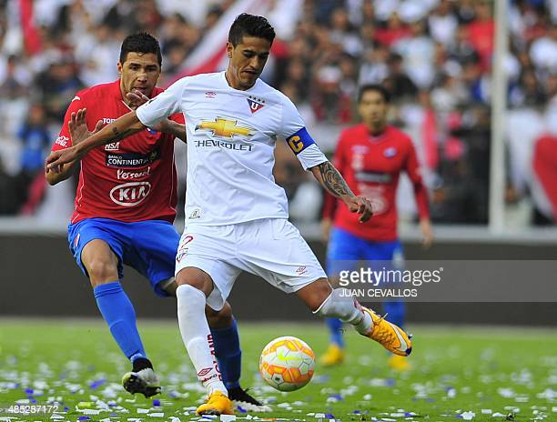 Norberto Araujo of Ecuador's Liga de Quito vies for the ball with Rodrigo Teixeira of Paraguay's Nacional during their Copa Sudamericana football...