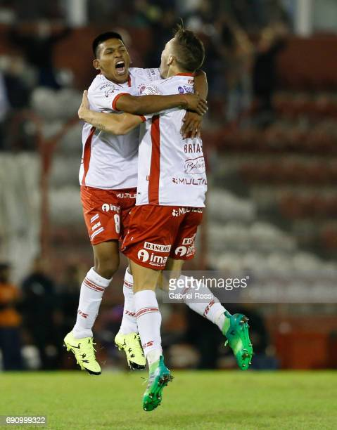 Norberto Briasco of Huracan celebrates the second goal of his team with Leandro Cuomo during a second leg match between Huracan and Deportivo...
