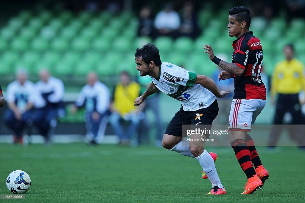 Norberto of Coritiba competes for the ball with Joao Paulo of Flamengo during the match between Coritiba and Flamengo for the Brazilian Series A 2014 at Couto Pereira stadium on August 17, 2014 in Curitiba, Brazil.