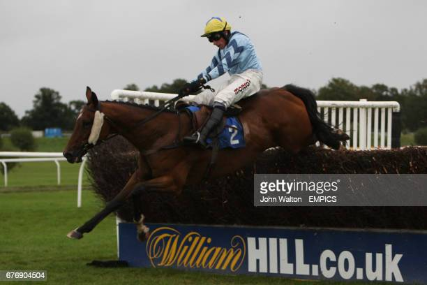 Norborne Bandit ridden by Harry Skelton jumps the fence during the Betfair iPhone Android App Handicap Chase