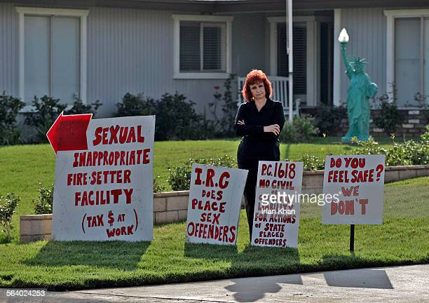 Norco Feb21 2007 Julie Waltz has many signs posted on her front lawn protesting the placement of sex offenders in a group home next door seen in the...
