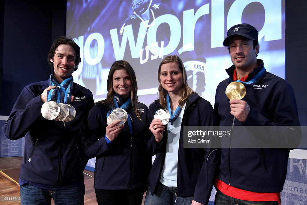 Nordic combined athlete <a gi-track='captionPersonalityLinkClicked' href=/galleries/search?phrase=Johnny+Spillane&family=editorial&specificpeople=726088 ng-click='$event.stopPropagation()'>Johnny Spillane</a>, alpine skiier <a gi-track='captionPersonalityLinkClicked' href=/galleries/search?phrase=Julia+Mancuso&family=editorial&specificpeople=214615 ng-click='$event.stopPropagation()'>Julia Mancuso</a>, hockey player <a gi-track='captionPersonalityLinkClicked' href=/galleries/search?phrase=Angela+Ruggiero&family=editorial&specificpeople=220275 ng-click='$event.stopPropagation()'>Angela Ruggiero</a> and snowboarder <a gi-track='captionPersonalityLinkClicked' href=/galleries/search?phrase=Seth+Wescott+-+Snowboarder&family=editorial&specificpeople=240569 ng-click='$event.stopPropagation()'>Seth Wescott</a> pose with their medals after participating in a VISA Athlete Panel on February 26, 2010 in Vancouver, Canada.