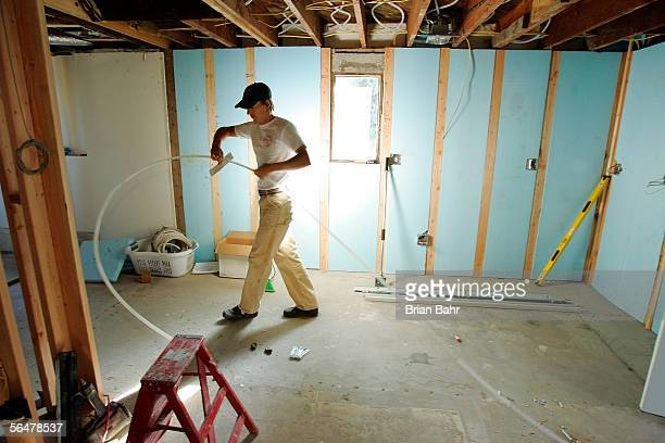 Nordic combined skier Todd Lodwick installs Wirsbow radiant heating below the floor of his kitchen while renovating his basement on September 21 2005...