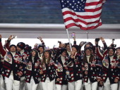 Nordic combined skier Todd Lodwick of the United States Olympic team carries his country's flag during the Opening Ceremony of the Sochi 2014 Winter...