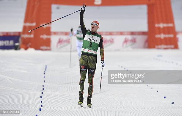 Nordic Combined winner Eric Frenzel of Germany celebrating after the Men's Nordic Combined Individual Gundersen cross country skiing at the Nordic...