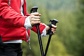 Nordic Walking in Autumn mountains, hiking concept