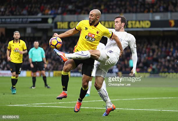 Nordin Amrabat of Watford and Christian Fuchs of Leicester City battle for possession during the Premier League match between Watford and Leicester...