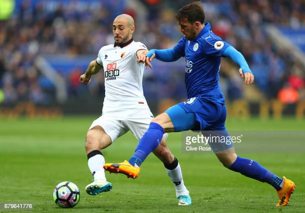 Nordin Amrabat of Watford and Christian Fuchs of Leicester City battle for possession during the Premier League match between Leicester City and...