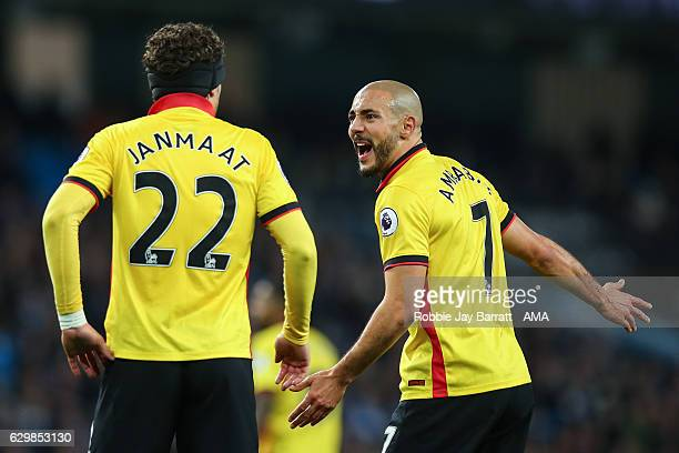 Nordin Amrabat of Watford and Daryl Janmaat of Watford argue during the Premier League match between Manchester City and Watford at Etihad Stadium on...