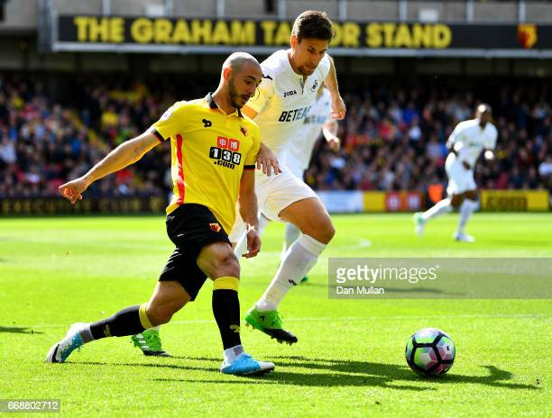 Nordin Amrabat of Watford and Fernando Llorente of Swansea City battle for possession during the Premier League match between Watford and Swansea...