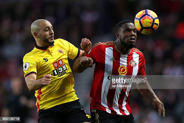 Nordin Amrabat of Watford and Victor Anichebe of Sunderland battle to win a header during the Premier League match between Sunderland and Watford at...