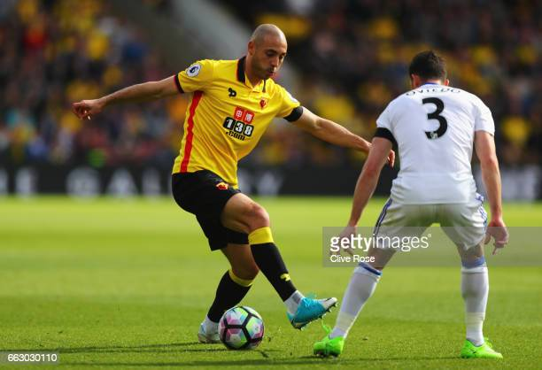 Nordin Amrabat of Watford attempts to take the ball past Bryan Oviedo of Sunderland during the Premier League match between Watford and Sunderland at...