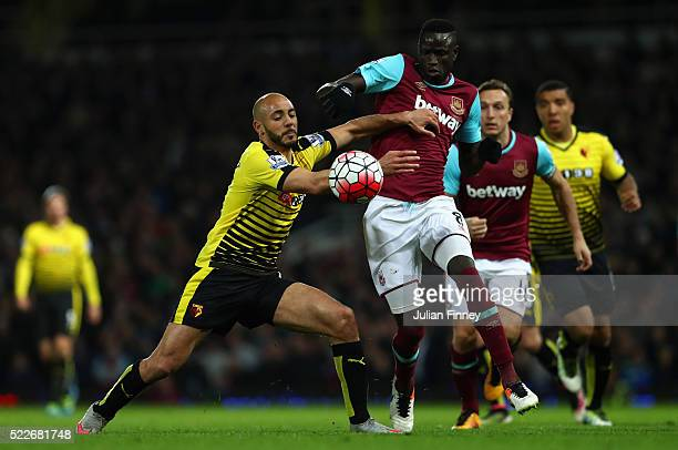 Nordin Amrabat of Watford closes down Cheikhou Kouyate of West Ham United during the Barclays Premier League match between West Ham United and...