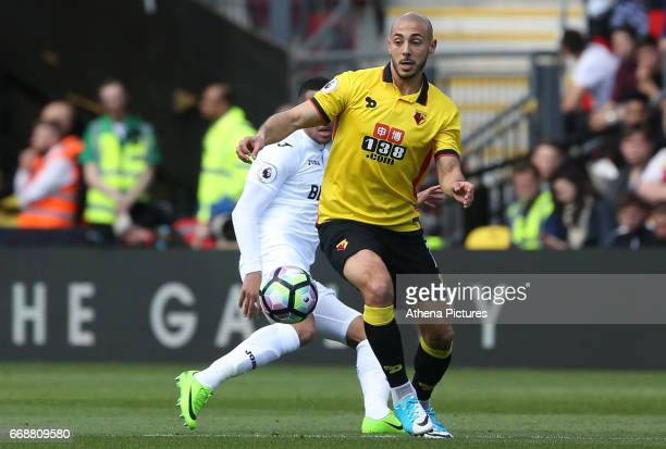 Nordin Amrabat of Watford is closely marked by Martin Olsson of Swansea City during the Premier League match between Watford and Swansea City at...