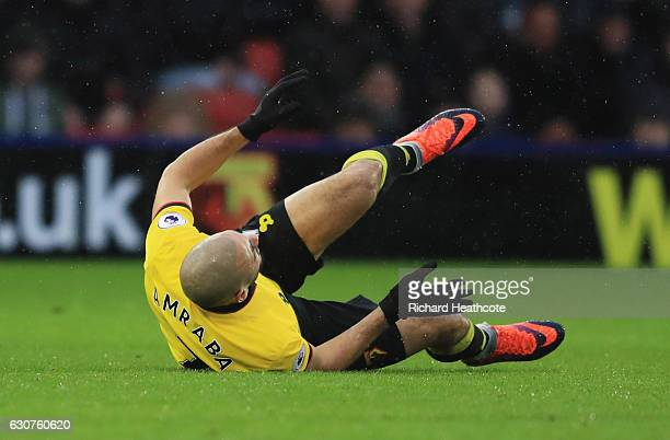 Nordin Amrabat of Watford is injured as he tumbles during the Premier League match between Watford and Tottenham Hotspur at Vicarage Road on January...