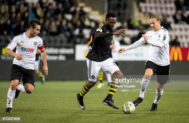 Nordin Gerzic of Orebro SK Chinedu Obasi of AIK Arvid Brorsson of Orebro SK during the Allsvenskan match between Orebro SK AIK at Behrn Arena on...