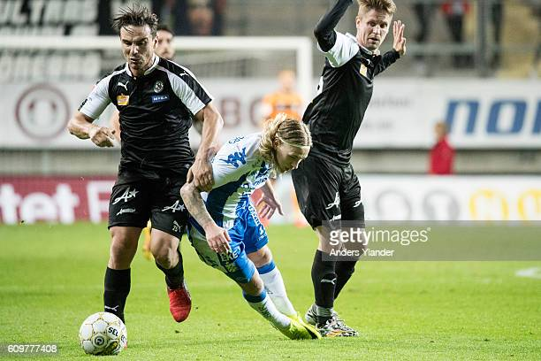 Nordin Gerzic of Orebro SK Martin Lorentzson of Orebro SK and Elias Mar Omarsson of IFK Goteborg fights for the ball during the Allsvenskan match...
