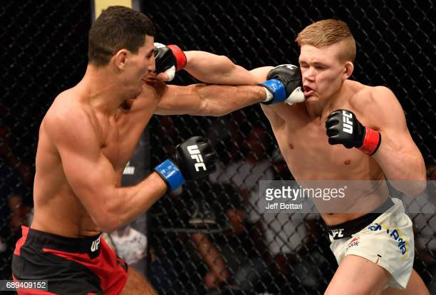 Nordine Taleb punches Oliver Enkamp in their welterweight fight during the UFC Fight Night event at the Ericsson Globe Arena on May 28 2017 in...
