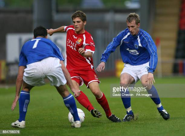 FC Nordsjaelland's Soren Christensen holds off Queen of the South's Craig Reid during the UEFA Cup Second Qualifying Round First Leg at the Excelsior...