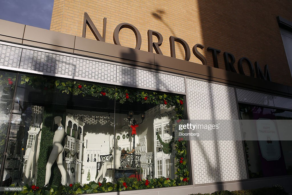 Nordstrom Inc. signage is displayed outside as a holiday window display is under construction at a department store in Santa Monica, California, U.S., on Tuesday, Nov. 12, 2013. Nordstrom Inc. is scheduled to release earnings figures on Nov. 14. Photographer: Patrick T. Fallon/Bloomberg via Getty Images