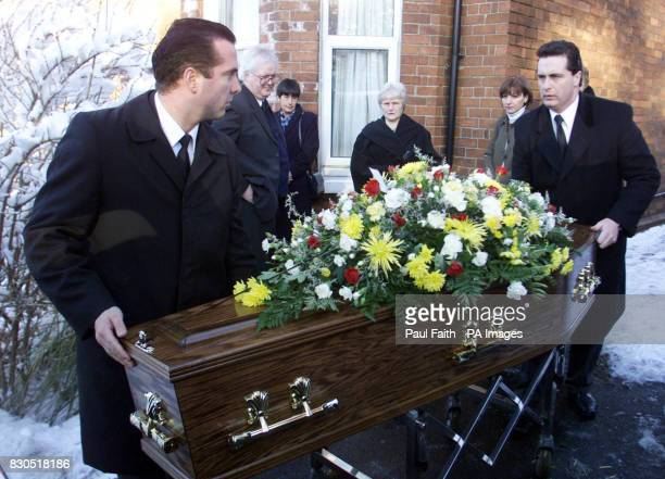 Noreen Hill wife of Ronnie Hill watches as her husband's coffin is removed from his home in Holywood Belfast Mr Hill was in a coma for 13 years...