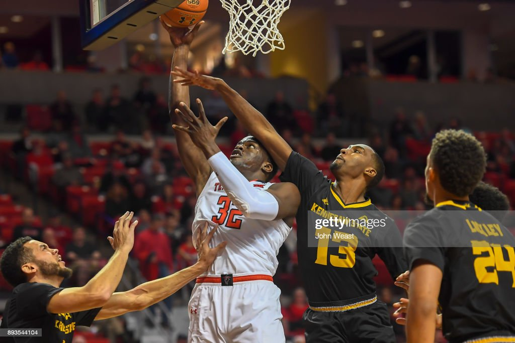 Norense Odiase #32 of the Texas Tech Red Raiders shoots the ball against the defense of Tristan Jarrett #13 of the Kennesaw State Owls during the game on December 13, 2017 at United Supermarkets Arena in Lubbock, Texas. Texas Tech defeated Kennesaw State 82-53.