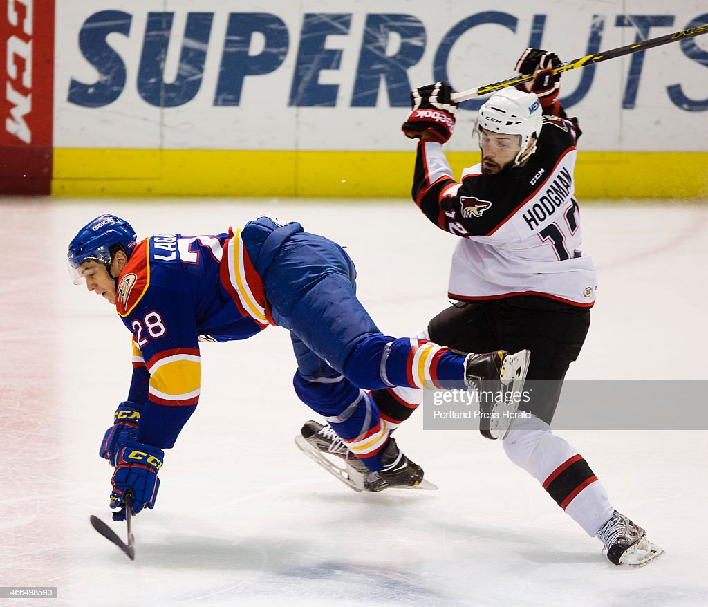 Norfolk Admirals center Antoine Laganiere trips up against Portland Pirates center Justin Hodgman during first period AHL action at Cross Insurance...