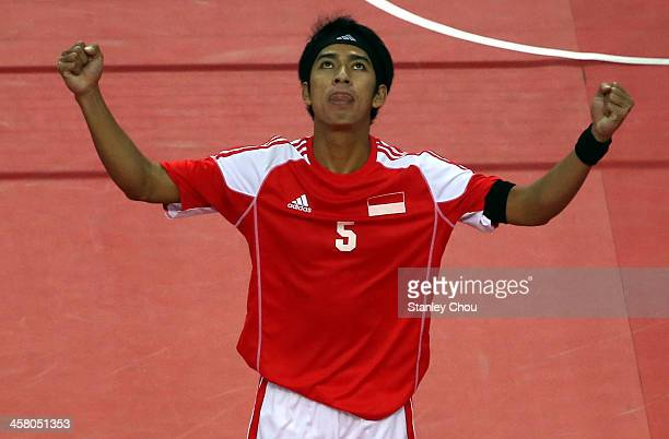 Norfrisal of Indonesia celebrates after his team defeated Burma during the Men's Team Double Final of the Sepak Takraw Competition during the 2013...