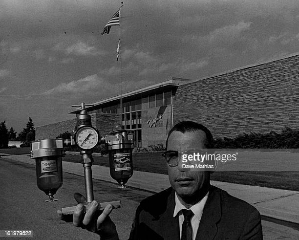 SEP 19 1962 SEP 26 1962 Norgren CA CO Plant manager Paul Williams displays one of CA Norgren's famous products a combination airline filter pressure...