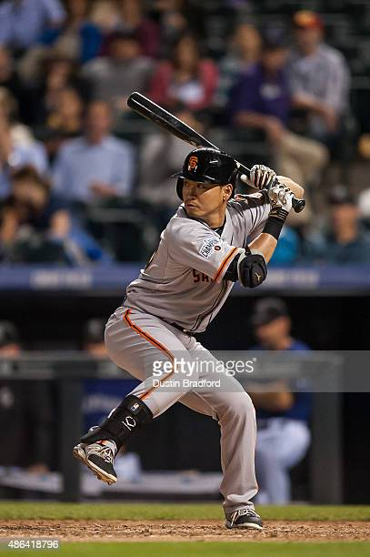 Nori Aoki of the San Francisco Giants bats in a seventh inning pinch hit appearance during a game at Coors Field on September 3 2015 in Denver...